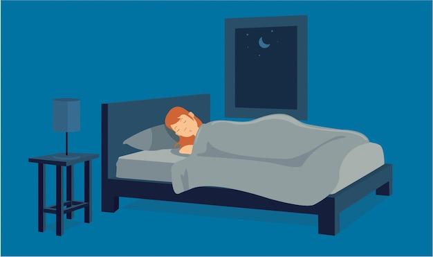 若い女性は疲れて彼女のアパートで眠っている