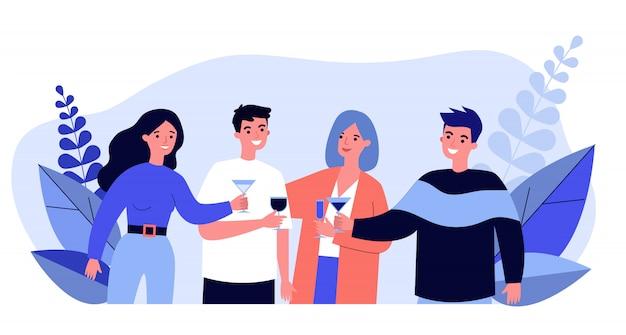 Молодые друзья пьют коктейли на вечеринке