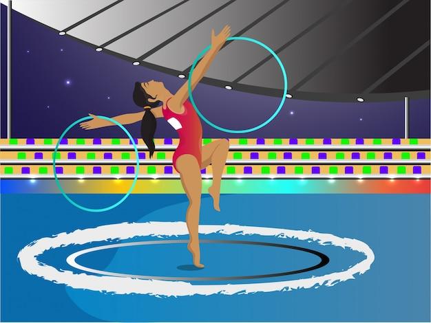 Молодая девушка делает гимнастику с обручами