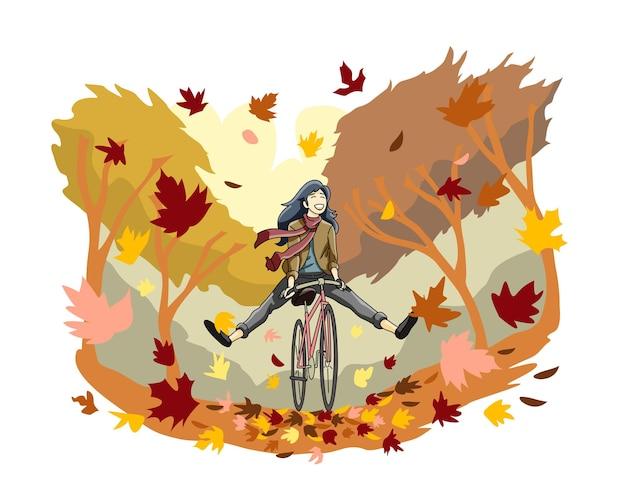 若い女の子幸せな秋の自転車に乗る