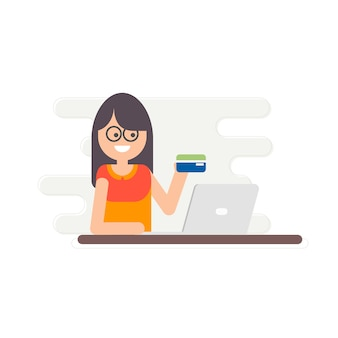 Young girl holding a credit card