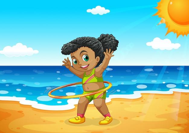 Young girl hoola hooping on beach