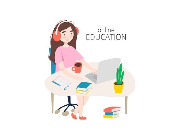 ノートパソコンを机で勉強していた若い女の子