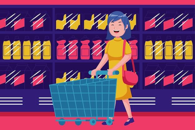 슈퍼마켓에서 트롤리와 함께 산책하는 어린 소녀.
