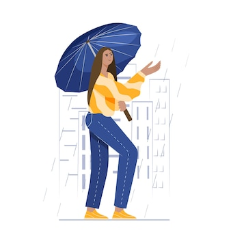 A young girl walks through the city on a rainy day with an umbrella