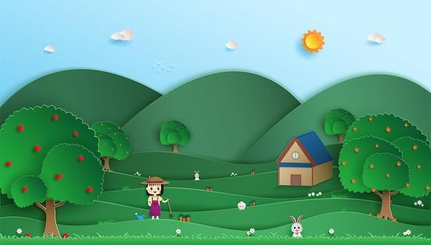 Молодая девушка с огородом. и его фруктовый сад. и вид на природу, зеленый лес.