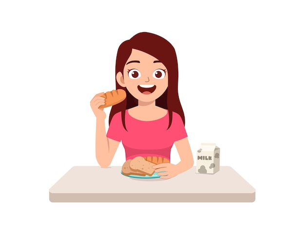 Young good looking woman eat bread and drink milk