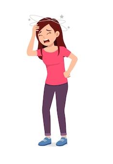 Молодая красивая женщина чувствует головную боль и боль