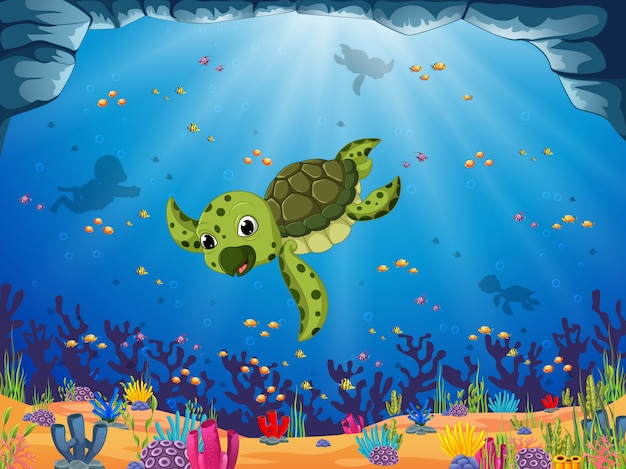 A young green turtle is swimming under the blue sea view