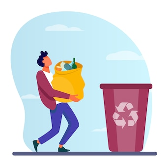 Young guy carrying bag with garbage to trash bin