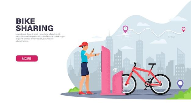若い男は街を旅行するために自転車を借ります