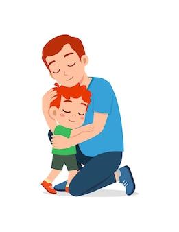 젊은 행복 한 아버지는 귀여운 어린 소년을 포옹