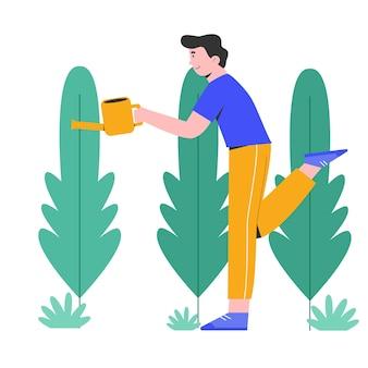 植物を洗い流す若い幸せな男