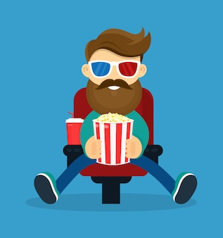 Young happy smiling beard hipster man in cinema. in 3d glasses and popcorn watching movie film.