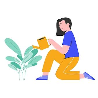 植物を洗い流す若い幸せな女性