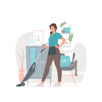 モダンなアパートメントの床を掃除する若い主婦