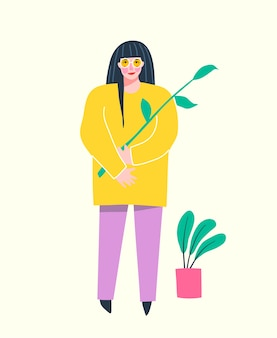 若い女性が花を持って立っている、グリーティングカードやtシャツのトレンディな楽しいスタイル。