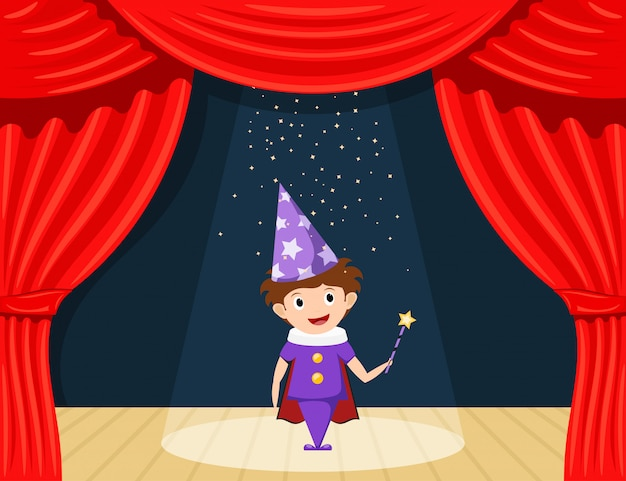 Young magician on stage. children's performance. small actor on stage playing the role of a wizard.