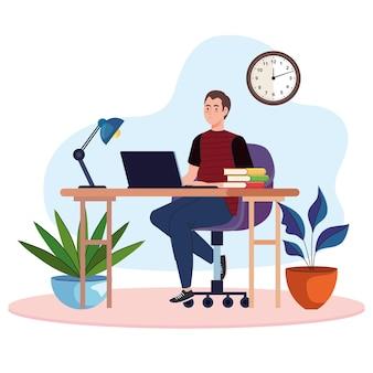 노트북을 사용하는 책상에 젊은 남성 프리랜서 작업자