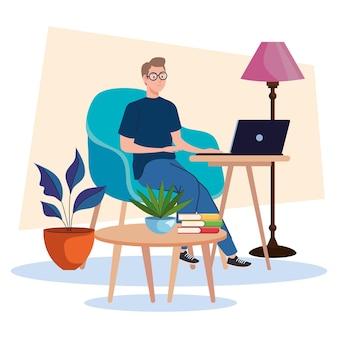 ノートパソコンを使用してソファに座っている若い男性のフリーランサー労働者