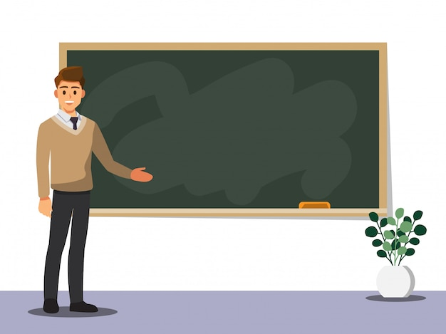 Young male teacher on lesson at blackboard in classroom