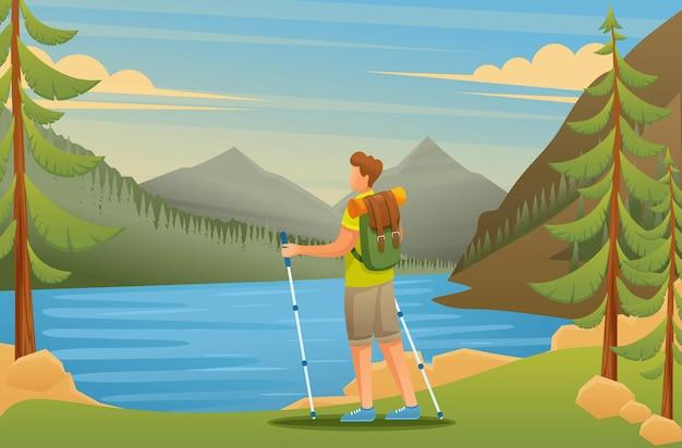 젊은 남자는 호수에 자연의 아름다움을 존경합니다