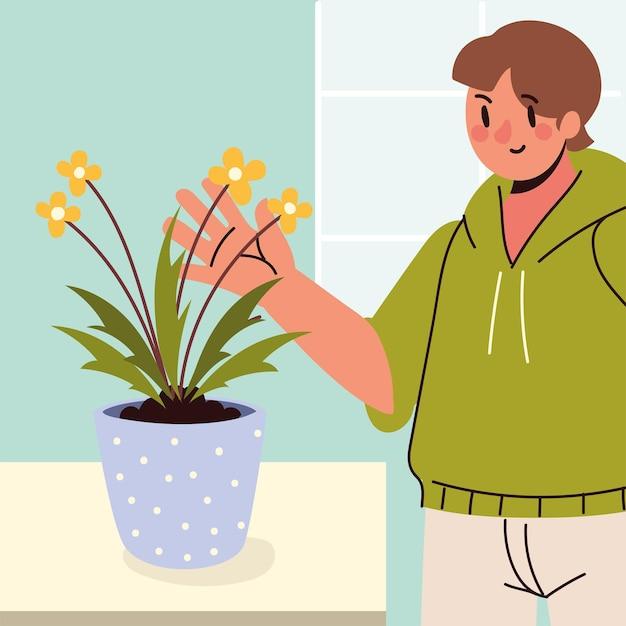 젊은 남자와 관엽 식물 관리