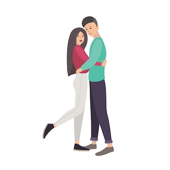 若い男性と女性が一緒に立っていると抱きしめるモダンなカジュアルな服を着て