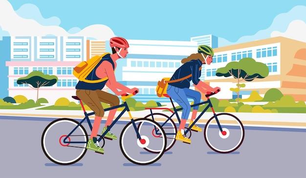 젊은 남자와 여자는 안전 헬멧을 쓰고 도시 주변을 자전거