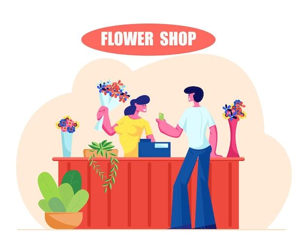Молодой человек покупает букет в цветочном магазине