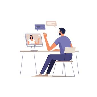젊은 남자는 컴퓨터를 사용하여 온라인으로 통신합니다. 장치 화면에 여자입니다.