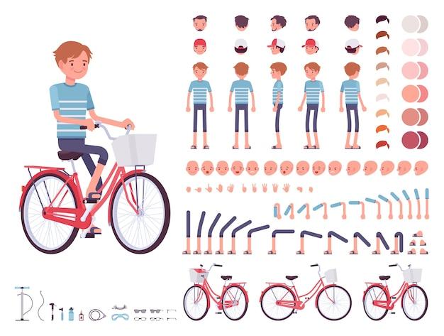 Молодой человек на велосипеде по городу