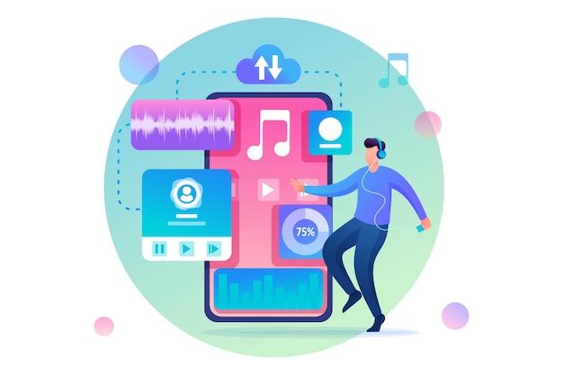 彼の携帯電話で再生されている音楽に合わせて踊っている若い男。ソーシャルネットワークで音楽を聴く。平らな