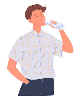 젊은 남자는 병에서 물을 마신다.