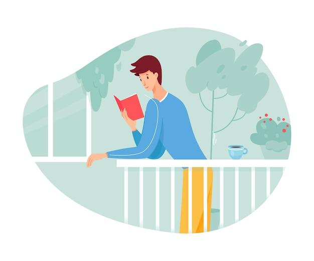 若い男はテラスで紙の本とバルコニーの男に立って読書を楽しむ