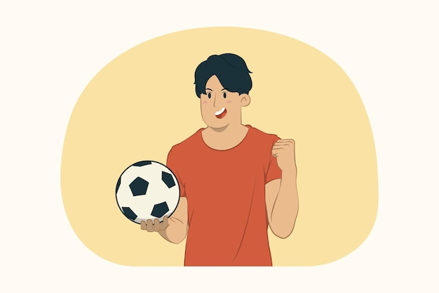Young man football fan hold soccer ball doing winner gesture