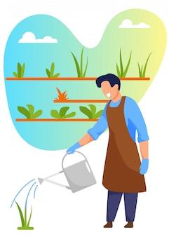 Young man gardener or florist watering plants
