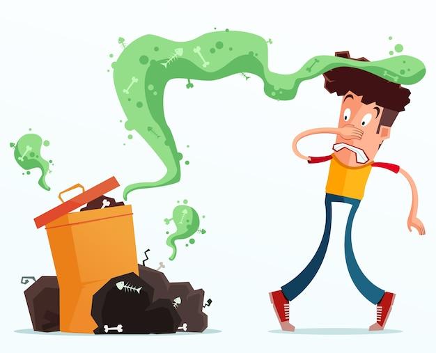 젊은 남자는 냄새 나는 쓰레기 때문에 짜증을 낸다.
