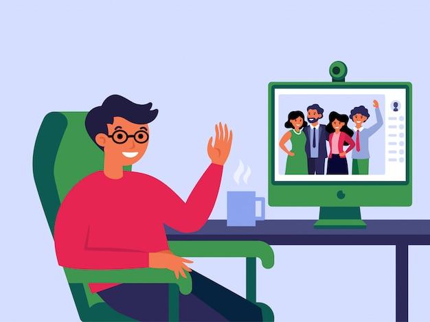 Молодой человек, имеющий онлайн-чат с семьей
