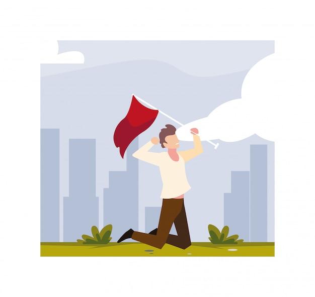 赤い旗を保持している若い男