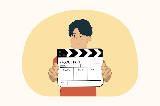 Young man holding in hands classic black film making clapperboard concept
