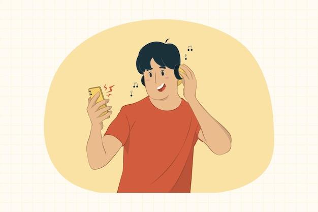 젊은 남자 스마트 폰 들고 헤드폰 개념으로 듣는 음악