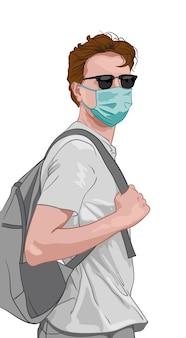 Молодой человек в серой одежде и синей маске для лица