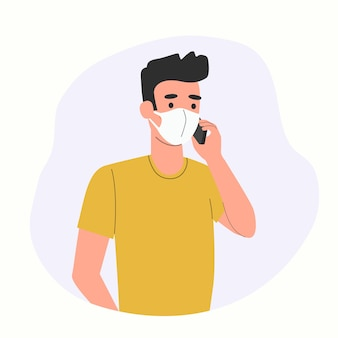 마스크를 쓴 젊은 남자가 스마트폰에 고립되어 있습니다.