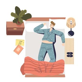 Молодой человек в пижаме спит в постели в удобном положении. мужской мультипликационный персонаж дремлет