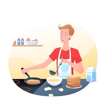 젊은 남자는 부엌, 아침 시간, 아침에 팬케이크를 요리하고 있습니다. 팬케이크를 요리하는 행복한 남자