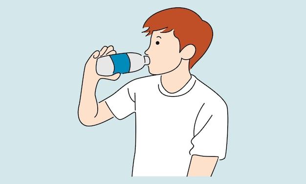 Молодой человек пьет воду из бутылки