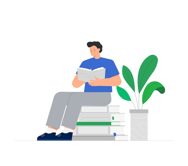 Young man is sitting on a stack of books and reading a book, near green flower in pot.