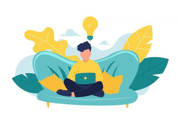 若い男はラップトップで自宅のソファーに座っています。コンピューターでの作業。フリーランス、オンライン教育またはソーシャルメディアの概念。白で隔離される図