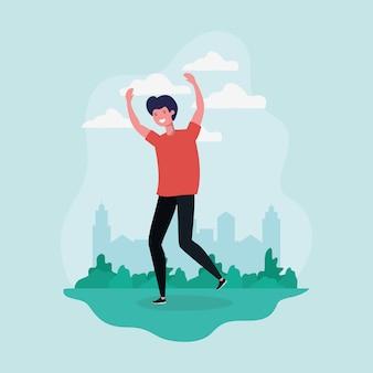 若い男が公園の文字で祝ってジャンプ